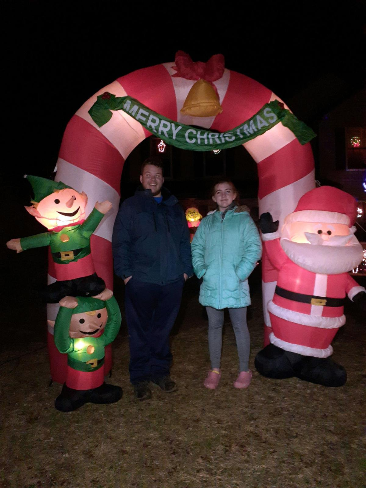 Noah Shingledecker, left, and his sister Emily, set up and take down 80 to 90 blowup decorations