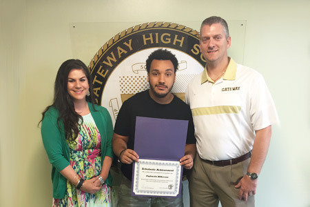 Pictured from Left to Right: Katie Bischak, Director of High School Operations; Carpentry and Construction Scholarship Winner, Daykwahn Wilkerson and Pete Murphy (Principal)