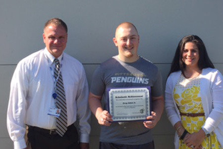Pictured from Left to Right: James Rummel, Principal/ Armstrong High School, Maintenance Electricity Scholarship Winner, Greg Johns Jr, and Katie Bischak, Director of High School Operations.