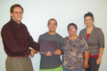 Pictured from Left to Right: Dave Shipe, School Director/Sunbury School; Paul Nye, Carpentry and Construction Scholarship Winner; Lisa Ritz (mother), Angela Mann, Admissions Representative/Sunbury School