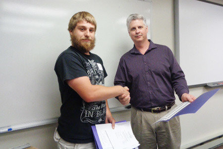 Pictured from Left to Right: Tristan Smith, RHVAC Scholarship Winner and George Thieler, School Director/Greensburg School